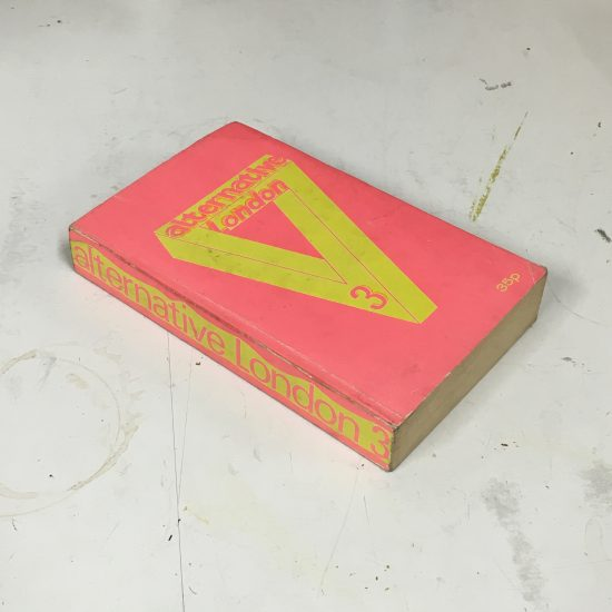 "Photo of the third edition of ""Alternative London"" by Nicholas Saunders, a paperback with a pink and yellow cover"