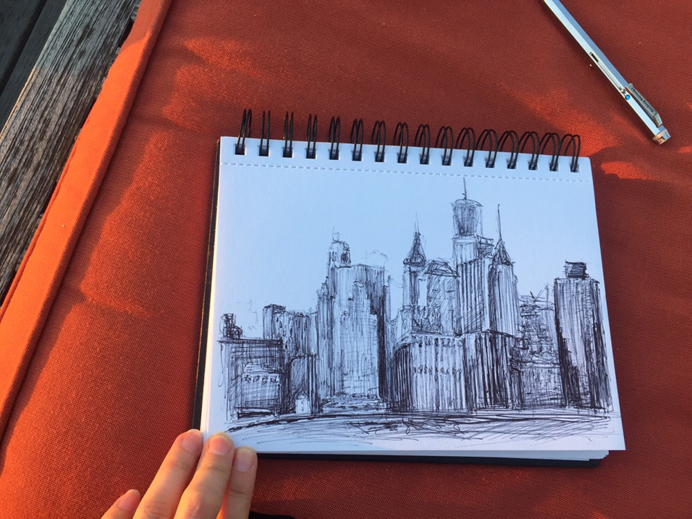 Pen sketch of the New York City skyline from a rooftop in Brooklyn by Piper Haywood