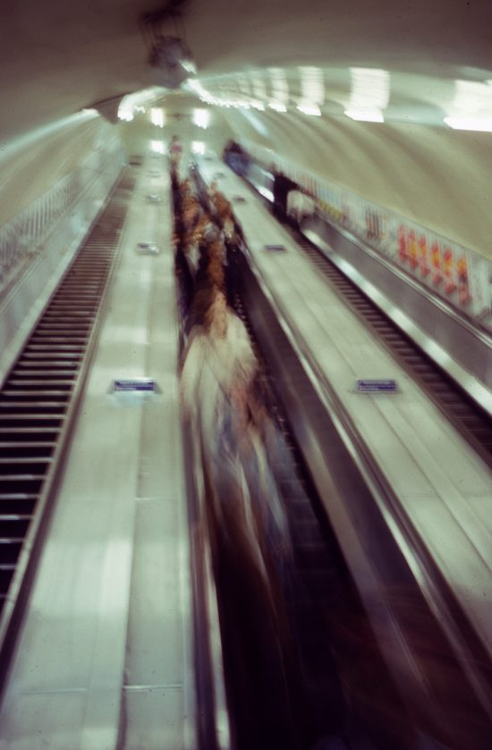 Blurry photograph of an escalator in a London underground station