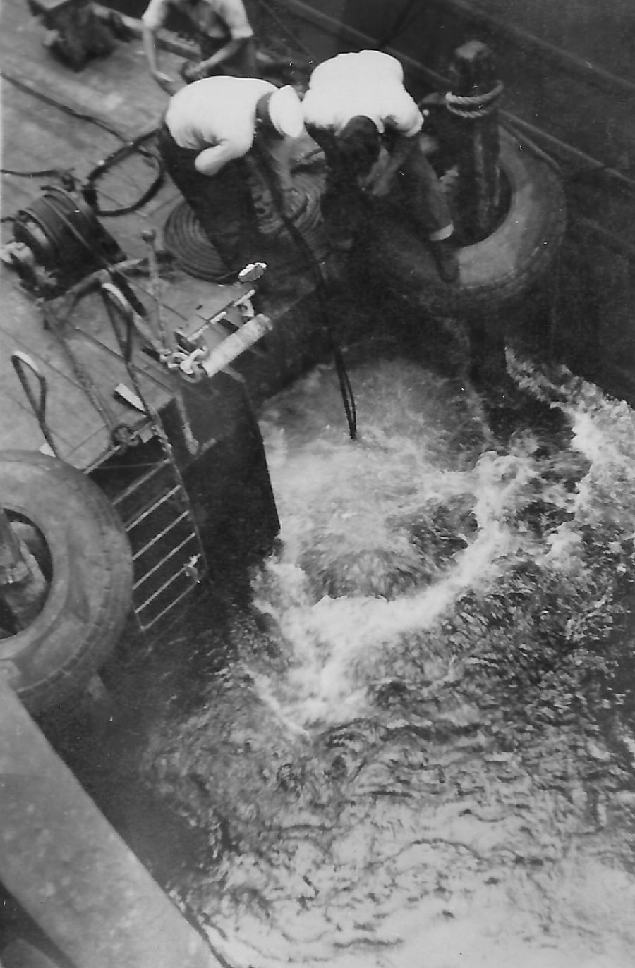 Diving for movie film in 40 ft of water during WWII. Photo taken by Bradley Piper or Renee Neuman.