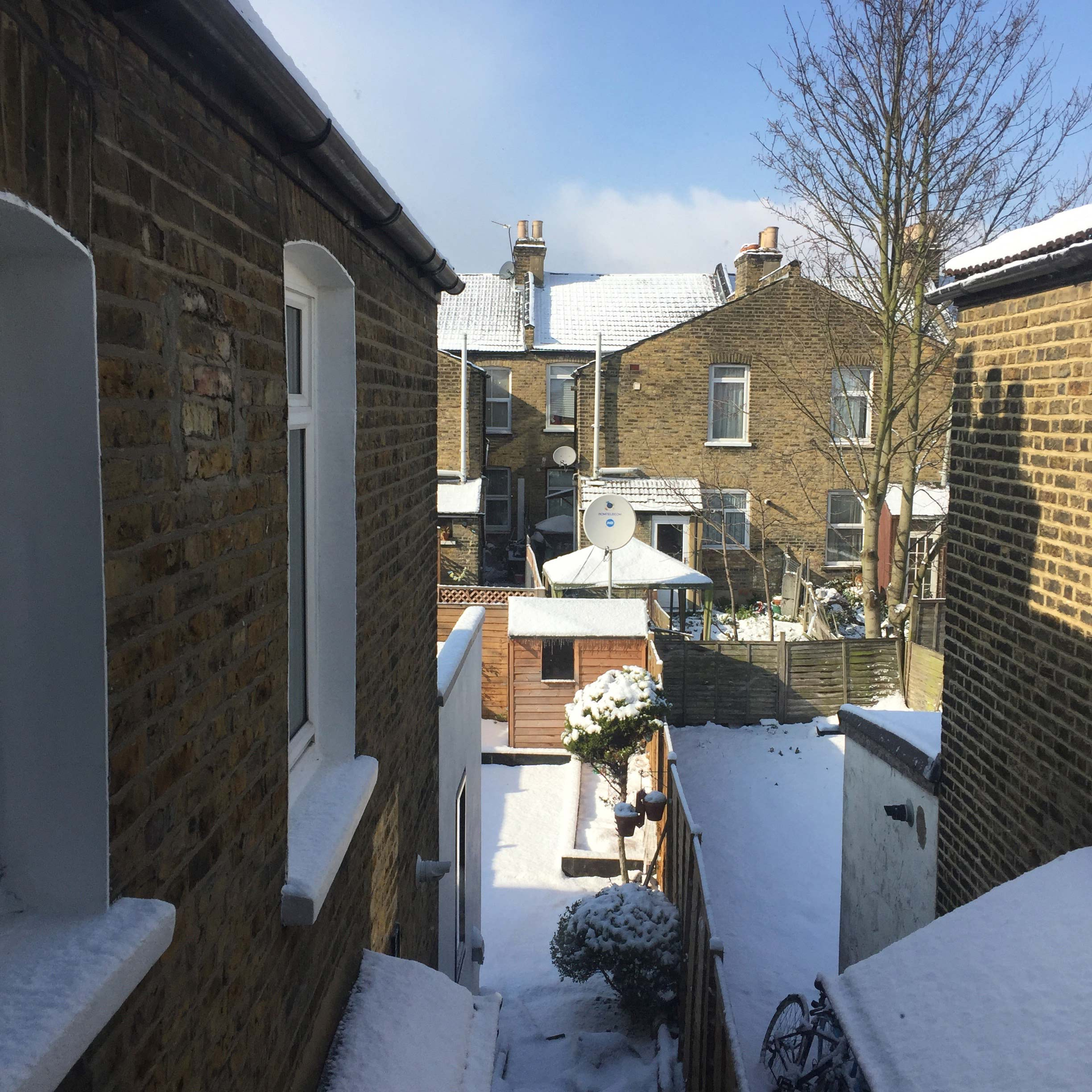 Snow on terraced houses in east London