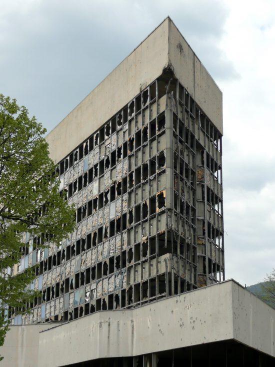 "The derelict facade of the Ljubljanska Banka Tower, or ""Sniper's Tower"", in Mostar (Bosnia and Herzegovina)"