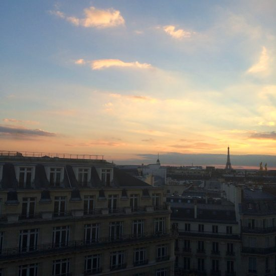 Parisian rooftops at sunset with the Eiffel Tower in the background