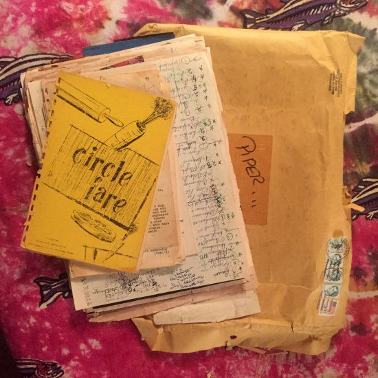 Stack of hand-written recipes on a tie dyed bedspread