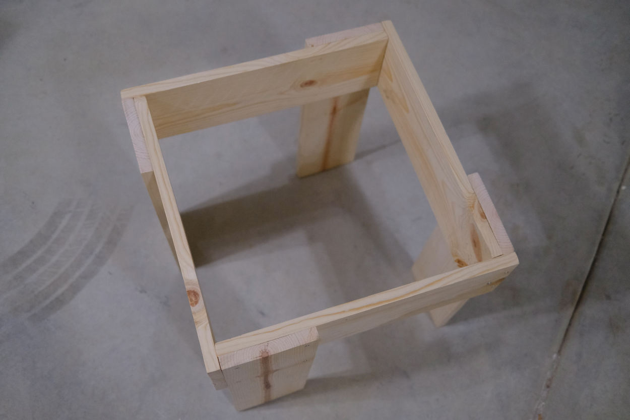 The assembled base of a Rietveld crate stool