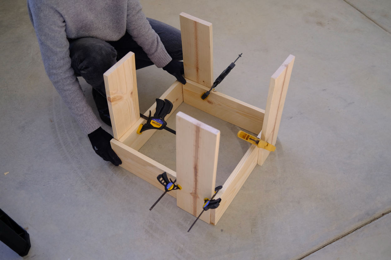 The clamped base of a Rietveld crate stool