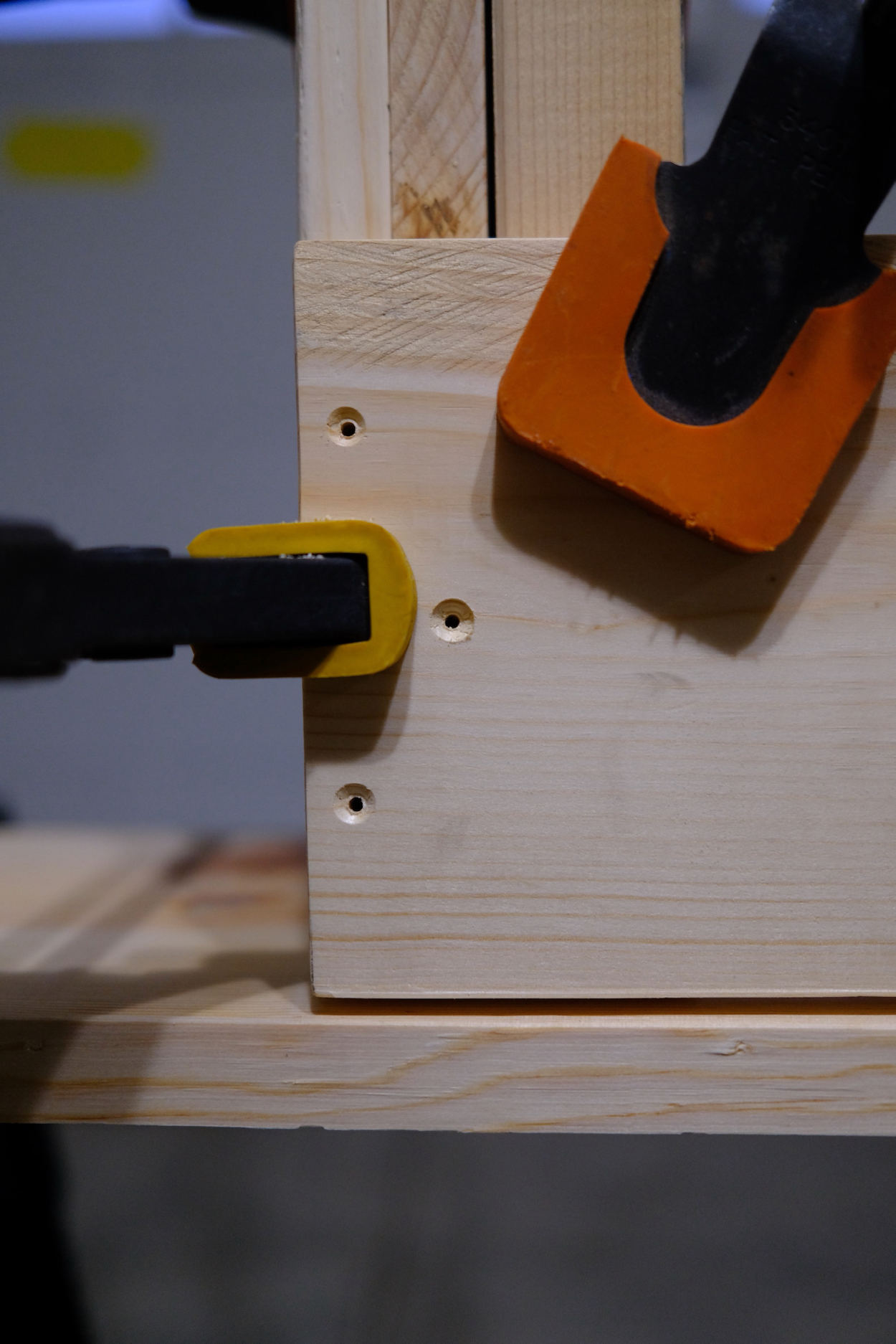 Pilot holes in the cross bar of a Rietveld crate stool