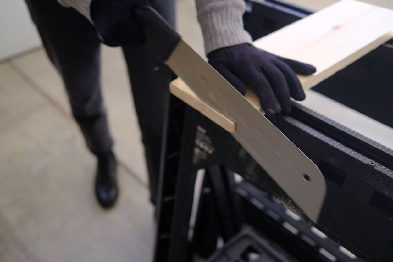 Sawing the end of a leg for a Rietveld stool