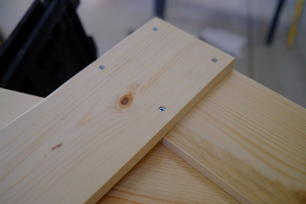 The leg and crossbar of a Rietveld crate stool