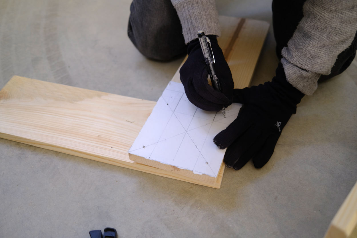 Marking pilot holes on the leg and crossbar of a Rietveld crate stool