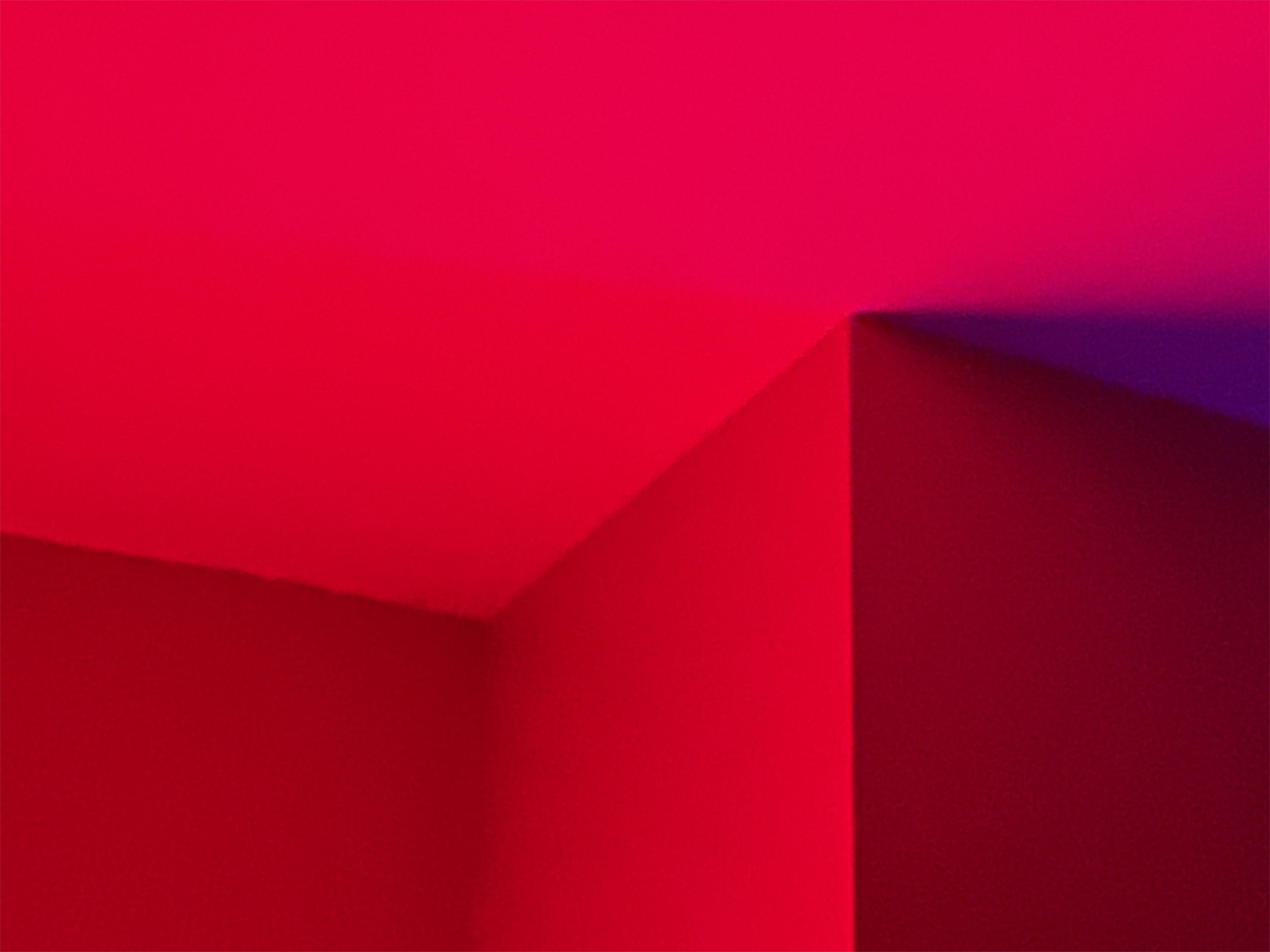 Corners of a room in red and blue light